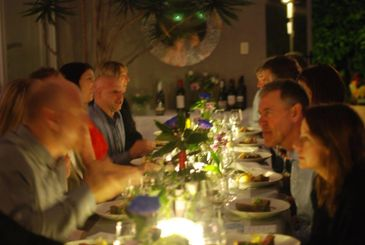 People enjoying Perth Chef Hires amazing birthday dinner party catering at home and waiter service.