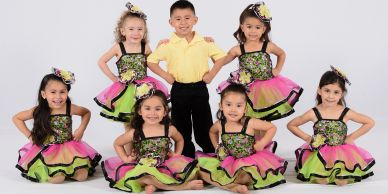 Dance group picture, yellow, pink, green dress