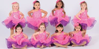 Dance group picture; purple and pink dress
