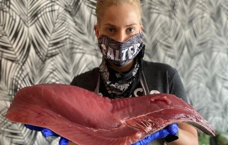 Chef Allison Fasano with a piece of fresh Tuna off the boat from Montauk, NY caught earlier that day