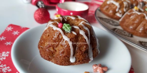 mini gingerbread bundt cakes with glaze and Christimas decorations