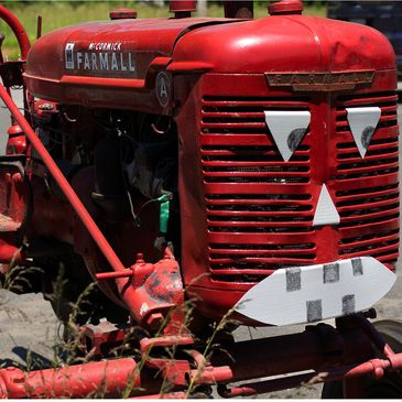 Farmall tractor with a spooky halloween face