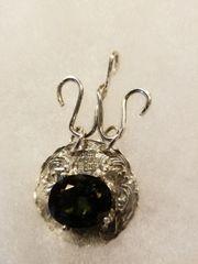 Moldivite on silver