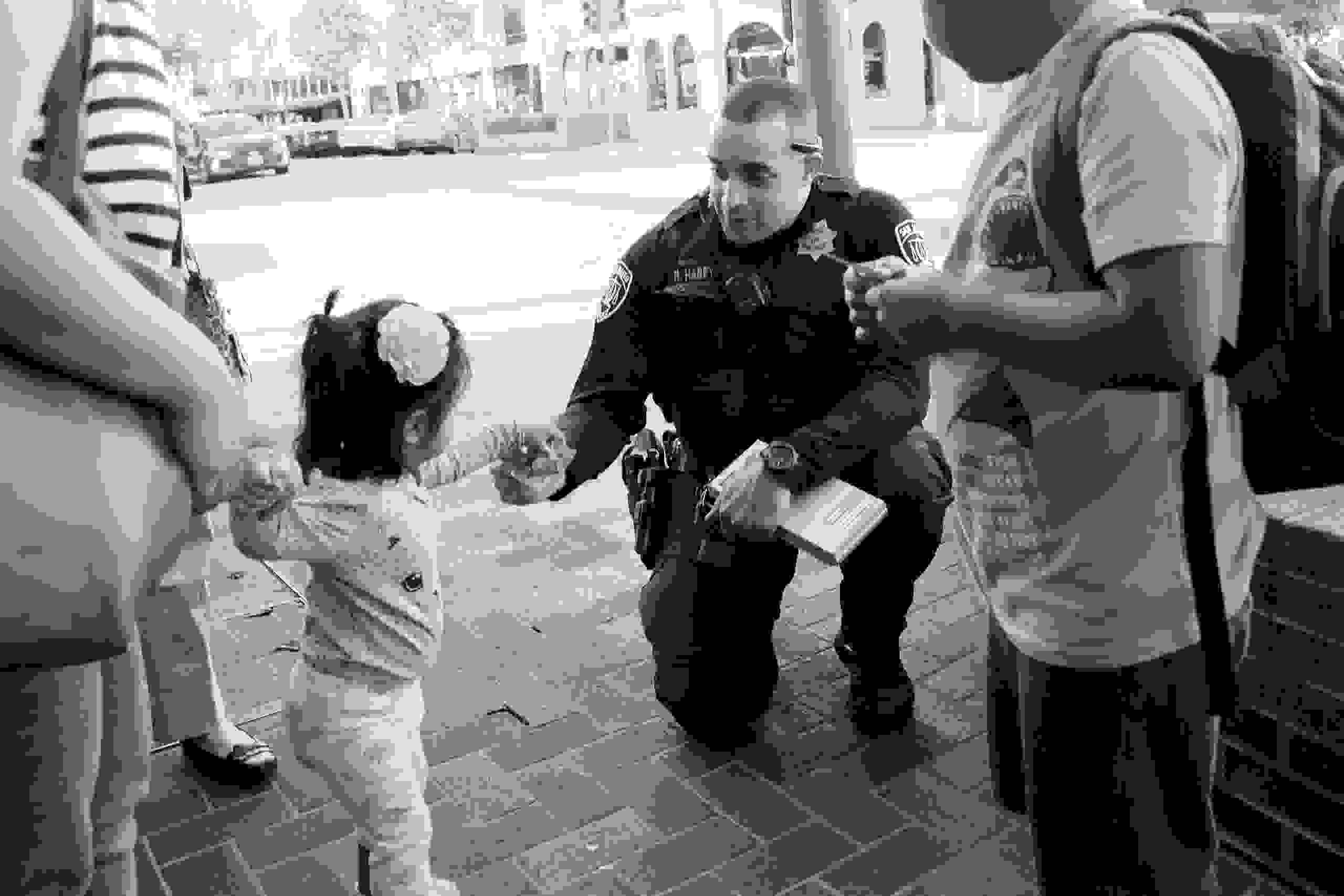 Police officer giving a sticker to a child.
