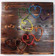 Handmade barbed wire wood decor piece