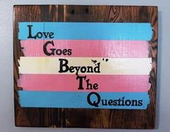 Handmade and hand painted LGBTQ Trans Flag wood decor piece