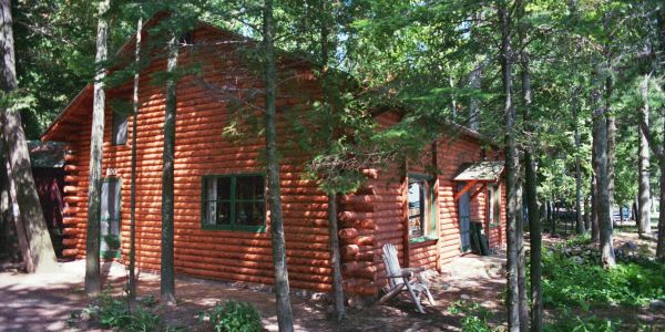 Woodsy quaint Higgins Lake waterfront log cabin makes for the perfect Michigan vacation destination up north