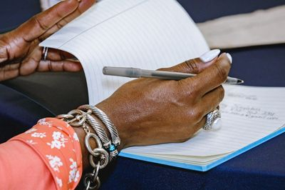 "Woman taking notes during first BPH event. Credit: David ""Odiwams"" Wright"