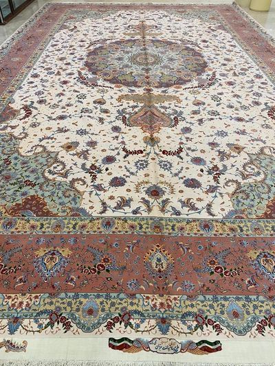 Tabriz Persian carpet. This signed carpet is 500 x 850 cms. Wool and silk luxury carpet.