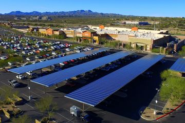 Aerial photography of a shopping center in Tucson,AZ  looking over solar panels in the parking lot