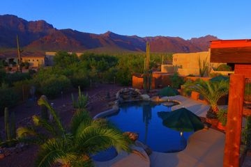 An evening shot of the Superstition Mountains in Gold Canyon, AZ. Low light evening shot with a pool