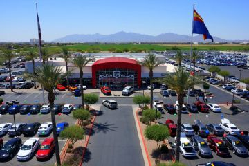 Aerial Video and Photography of Avondale Dodge RAM car dealership in Avondale, AZ looking down