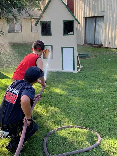 River Delta Firefighters giving kids an opportunity to squirt water at our structure fire prop.