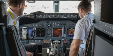 Commercial airline cockpit with pilots