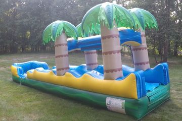 Tropical Slip and Slide Super fun for all ages.  Don't be afraid to get a running start.