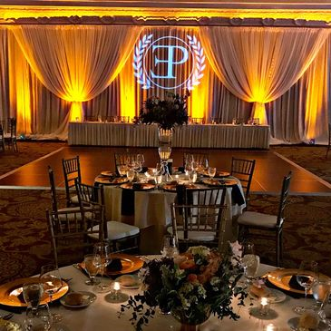 Corporate event holiday event lights uplights monogram gobo paradox productions Sentinel Hotel OR
