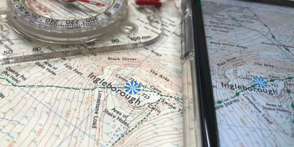 Map and compass with mapping and navigation app on a smartphone