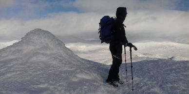 Mountaineer on summit of Cairngorm