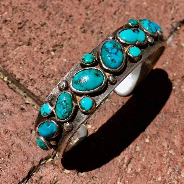 SOLD 1920s VIVID BLUE OVAL & ROUND 15 TURQUOISE STONE CROSS DIRECTIONAL STAMPED INGOT SILVER CUFF BRACELET