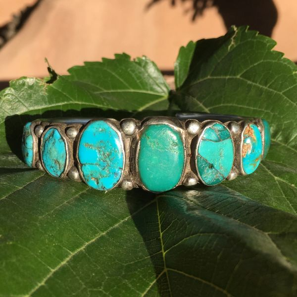 SOLD 1920s EARLY HANDMADE STAMPED INGOT SILVER 7 GREEN AND BLUE TURQUOISE ROW CUFF BIG WRIST