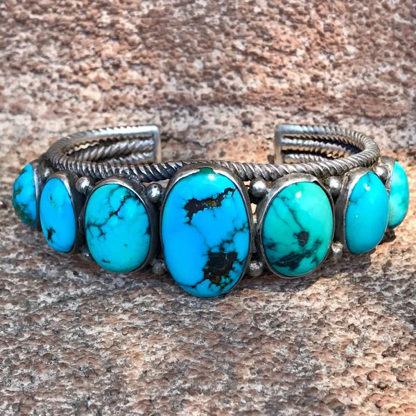SOLD 1920s TWISTED WROUGHT INGOT HAND PULLED WIRE AND 7 LIGHT BLUE STONES