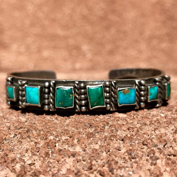 SOLD 1920s REPOUSSE' INGOT SILVER AND 7 SQUARE BLUE GEM TURQUOISE STONES CUFF BRACELET