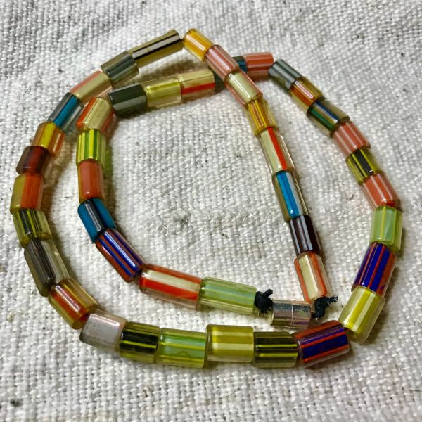 "1920s SILK ROAD REGION GLASS STRIPED CANDY CANE TRADE BEADS 22"" LONG"