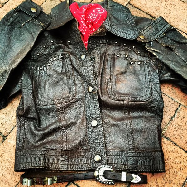 SOLD 1960S FRAMED LADIES SMALL VINTAGE STUDDED LEATHER BIKER JACKET, COWBOY BELT, BANDANNA SET