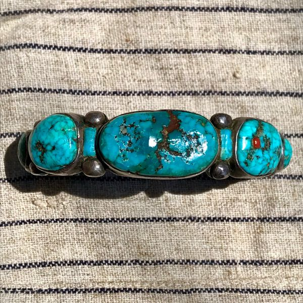 SOLD 1970s ZUNI PUEBLO HUMONGOUS GREASY NEON BLUE TURQUOISE NUGGETS WITH INLAID CORAL, TURQUOISE & HARDWOOD SANDCAST SILVER MENS CUFF BRACELET