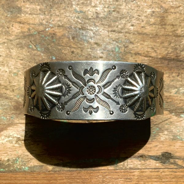 1910s EARLY CONCHO REPOUSSE FLEUR DE LIS, FLOWERS AND ARROWS STAMPED SILVER WIDE CUFF BRACELET
