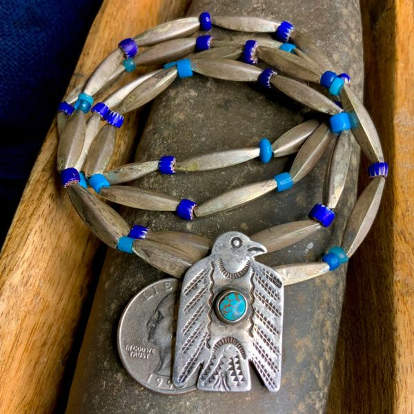 1910s SILVER THUNDERBIRD DOG TAG PENDANT WITH 1800s AMERICAN GLASS FUR TRADE BEADS AND LONG SILVER 1930s BENCH BEADS