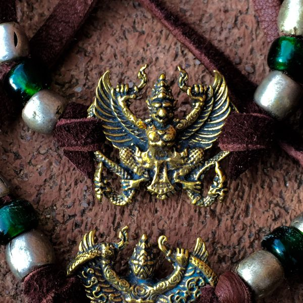 BRASS GARUDA on AMERICAN DEER SKIN