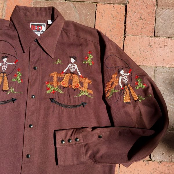 SOLD 1970s BROWN POLYESTER EMBROIDERED RODEO COWBOY SKELETONS WESTERN BLACK SNAP SHIRT