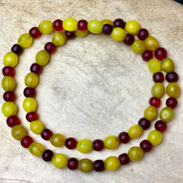 SOLD 1800s BIG HEAVY PUEBLO TRADE BEADS MANDREL WOUND MIX OF DARK TO NEON YELLOWS & DARK TO CHERRY REDS ATELIER RESTRUNG ON BLACK SINEW