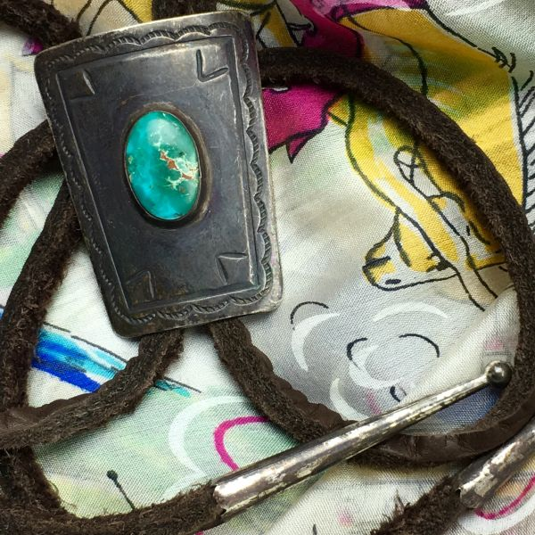 SOLD 1920s BLUE GREEN OVAL SMALL SILVER BOLO TIE WITH FILE STAMPS AMERICAN BUFFALO LEATHER & MANUFACTURED CONTEMPORARY SILVER TIPS