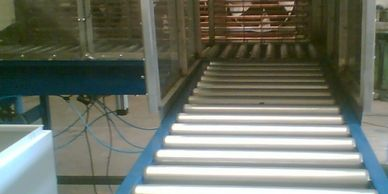 ROLLER CONVEYOR WITH CROSS TRANSFER