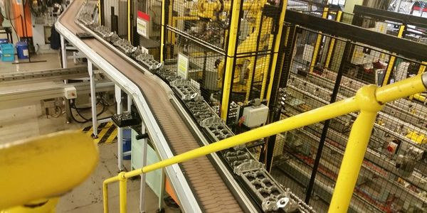 modular automotive conveyor for materials handling