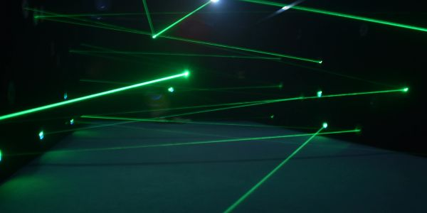 Green lasers shooting around inside of Laser Maze