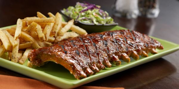 Plate of Tony Roma's ribs and French fries