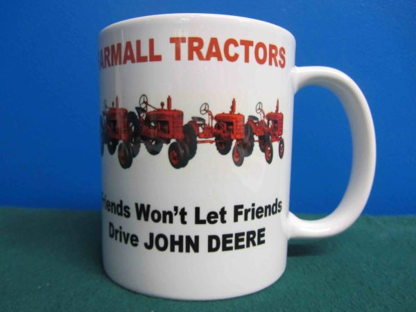 "FARMALL ""FRIENDS WON'T LET FREINDS DRIVE JOHN DEERE"" COFFEE MUG"
