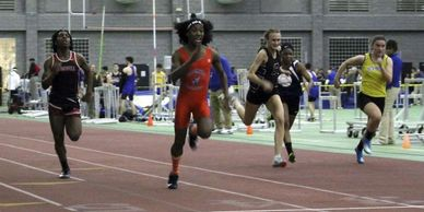 Chelsea Mitchell (wearing the black uniform with a C) running against male athletes that identify as females ( to the left of Chelsea)