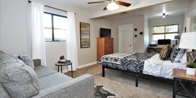 Tucson furnished rental near University of Arizona. Master bedroom with couch and desk.