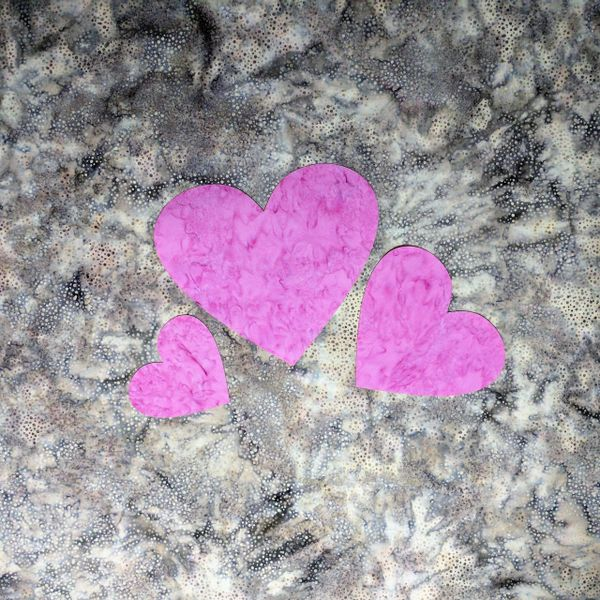 Set of three pink pre fused and laser cut heart appliques