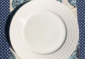 White dinner plate with lined rim