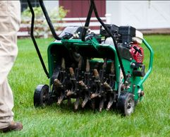 Lawn Care in Winnipeg. Lawn Aeration SErvice in winnipeg with spring cleanups and power raking turf.