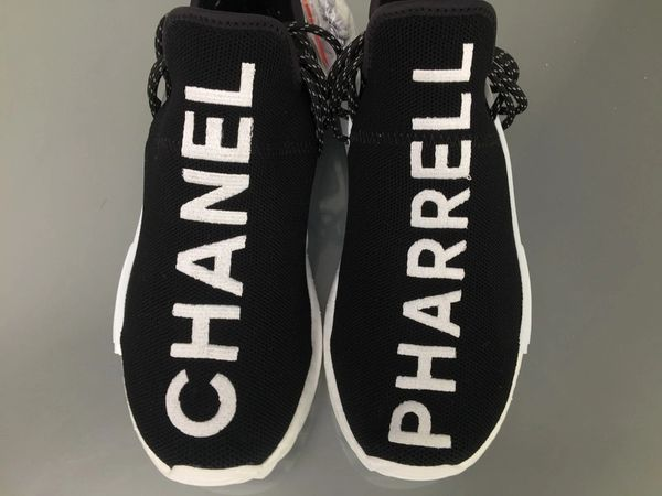 reputable site 3b4c5 6718f Adidas Black CHANEL x Pharrell NMD Human Race PK Sneakers
