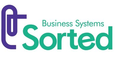 "Purple stylised paperclip and words ""Business Systems Sorted"" in green."