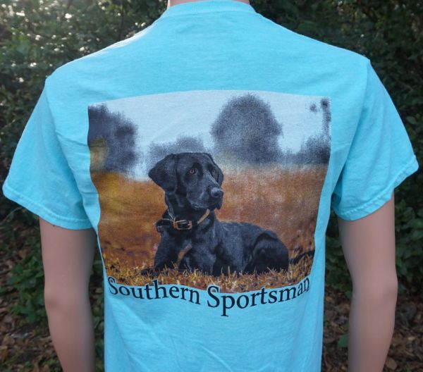 Black Labrador Retriever Lying In Field on Our Custom Aqua Short and Long Sleeve Shirts.