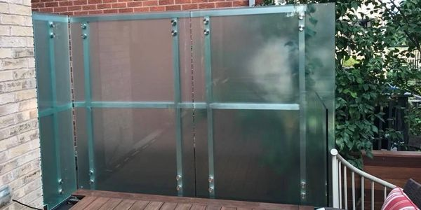 Custom Stainless Steel Residential Fence with acid-edge glass.
