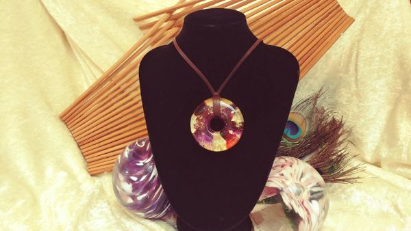 Gold, Black, Purple, and Orange Resin pendant on Suede Cord